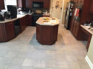 Kitchen floor spotless after tile and grout cleaning